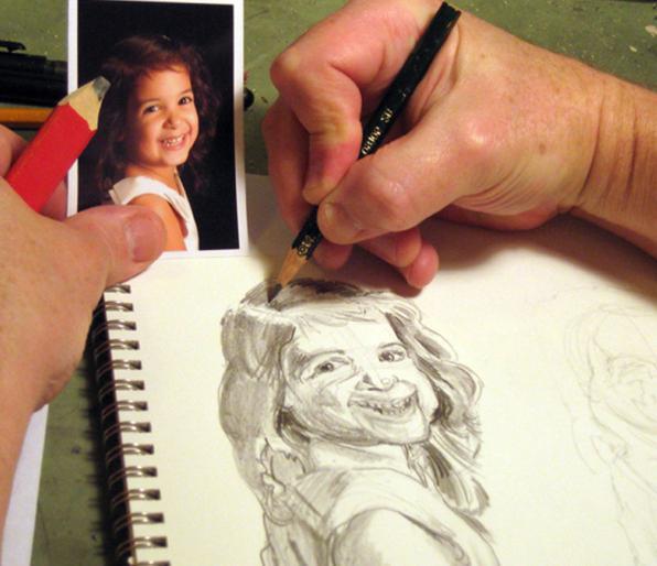 художник рисует портрет